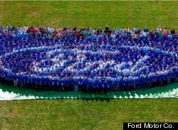 Ford owns its own logo again, after mortgaging it in 2006. Ford employees form the logo on the lawn of the company's Dearborn, Mich., headquarters.