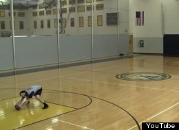 Nick DiChaira shows off his skills by sinking baskets with a football in his trick shot video.
