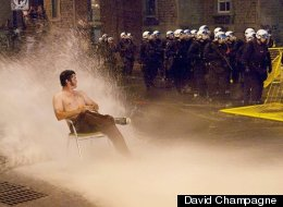 A photo of Cameron Collie, taken by David Champagne, sitting in the spray from a fire hydrant during protests in Montreal, Quebec is going viral online. (<a href=