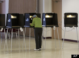 A lone voter casts a ballot in a downtown Miami condo complex, Tuesday, Jan. 31, 2012, during Florida's presidential primary.