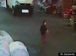 Hu Jun, the driver seen on this video, is on trial for allegedly running over and then leaving a toddler to die.
