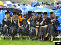 Graduates take cover under umbrellas during Yale University's commencement exercises in New Haven, Conn., Monday, May 21, 2012.