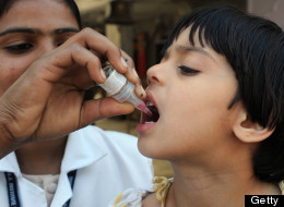 A girl receives polio vaccination drops from a medical volunteer during an immunisation drive in Amritsar on April 15, 2012. (NARINDER NANU/AFP/Getty Images)