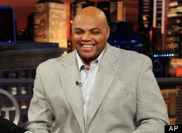 Marcelo Godoy, left, of the Spanish-language network SPACE, laughs with Inside the NBA analyst Charles Barkley while taping a promotional spot on the set at the TNT studios in Atlanta. (AP Photo/Erik S. Lesser)