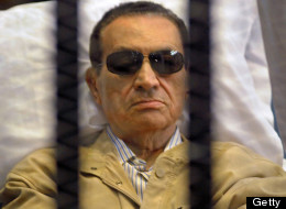 Hosni Mubarak sits inside a cage in a courtroom during his verdict hearing in Cairo on June 2, 2012. (STR/AFP/GettyImages)