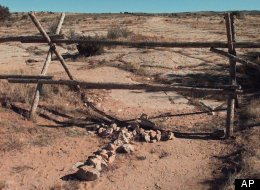 A cross made of stones rests below the fence in Laramie, Wyo., where, on Oct. 7, 1998, University of Wyoming gay college student Matthew Shepard was beaten and left for dead.