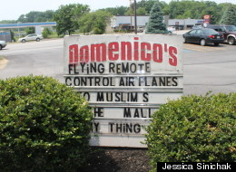Domenico's owner apologizes for this controversial sign placed outside of the restaurant.
