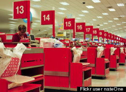 A cashier stands at a Target checkout line. Flickr user <a href=