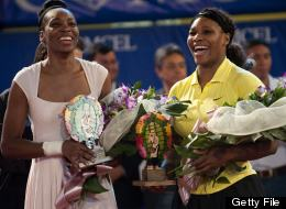 Venus Williams, left, and Serena Williams, right, smile at the end of a tennis match on Nov. 23, 2011.