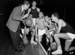 North Carolina University basketball coach Frank McGuire, left, gives his five starting players some pointers during a workout at Kansas City, Mo., Municipal Auditorium, on March 21, 1957. From left are : McGuire, Lennie Rosenbluth, Tom Kearns, Bob Cunningham, Pete Brennan, and Joe Quigg.