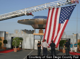 A real American flag is hoisted up next to a fake flying saucer at the San Diego County Fair, which is focused around a UFO theme this year. The Fair runs through July 4.