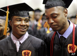 In this photo taken Saturday, June 12, 2010 Urban Prep High School graduating seniors Marcus Bass, left, smiles at classmate Cameron Barnes as Barnes reflects on the absence of his mother who died last year during graduation ceremonies in Chicago. when Cameron Barnes' mother died last year of liver disease, he returned to school the next day, finding solace there.