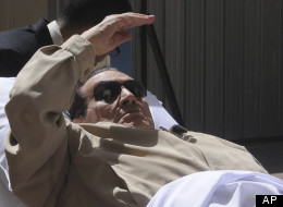 Egypt's ex-President Hosni Mubarak lays on a gurney as he arrives at the police academy courthouse in Cairo, Egypt, Saturday, June 2, 2012.  (AP Photo)