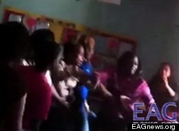 Screenshot from a video of parents brawling at a graduation (YouTube).