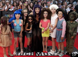 Sometimes the best accessory is a diminutive version of yourself. Just ask Katy Perry at this year's MMVAs.