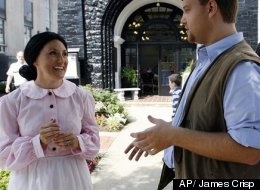 In this Saturday, June 9, 2012 photo, Barry Hatfield, right, dressed as Johnse Hatfield and Lynee Starr, left, as Roseanna McCoy discuss the history of the Hatfield-McCoy feud in front of the Coal House during the Hatfield-McCoy Reunion in Williamson, W.V.