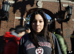 In this Nov. 18, 2011 photo, Harvard University student Lanya Olmstead stands in front of an entrance to the school's quad as passers-by stream by, in Cambridge, Mass. Ethnically, she considers herself half Taiwanese and half Norwegian. But when applying to Harvard, Olmstead checked only one box for her race: white. (AP Photo/Steven Senne)