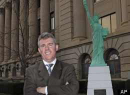 In this Nov. 30, 2011 photo, Colorado Secretary of State Scott Gessler poses for his picture at the courthouse in Greeley, Colo.