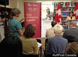 A family doctor crashed a funding announcement by Health Minister Leona Aglukkaq Wednesday as part of an aggressive campaign by some health care providers to protest Ottawa's planned limits on health services for refugees.