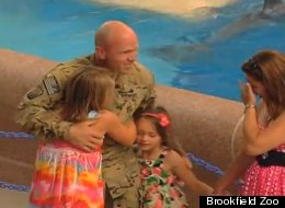Army Sergeant Keith Howse with daughters Nataja and Jorja. (Brookfield Zoo)