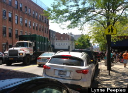 Garbage trucks rumble by PS 132 in North Brooklyn.