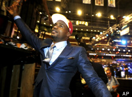 Florida State center Bernard James shakes spectators' hands moments after being picked with the third pick in the second round by the Cleveland Cavaliers during the NBA basketball draft, Thursday, June 28, 2012, in Newark, N.J. (AP Photo/Julio Cortez)