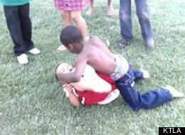 A shocking video was posted on Facebook Wednesday of two young boys fighting as a crowd of kids and at least two adults egg them on in Victorville, Calif.