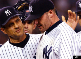 New York Yankees pitcher Roger Clemens is congratulated by manager Joe torre, left, as he is relieved in the eighth inning against the Boston Red Sox, Tuesday, Sept. 3, 2002 in New York. Catcher Jorge Posada is second from left and shortstop Derek Jeter is on the right. The Yankees won, 4-2, and Clemens finished with 10 strikeouts. (AP Photo/Mark Lennihan)