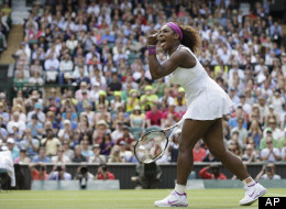 Serena Williams reacts after winning against Zheng Jie of China during a third round women's singles match at Wimbledon, Saturday, June 30, 2012.