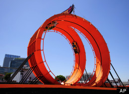 Stunt drivers Greg Tracy and Tanner Foust set a new Guinness World Record for successfully racing through a 60-foot-tall double vertical loop at the X Games Los Angeles on Saturday, June 30, 2012 in Los Angeles. (AP)