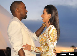 Kim Kardashian and Kanye West share a sweet moment at the the