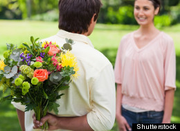 Men are more likely to shell out if their date is attractive, a study finds.