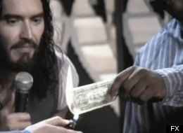 Russell Brand burns a dollar bill on television