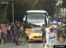 The Olympic torch's security team got to grips with a cyclist