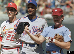 Philadelphia Phillies Mike Schmidt (right) tugs on New York Mets right fielder Darryl Strawberry's first baseman's mitt as he showed up with the odd glove at on Monday, July 13, 1987 All-Star workout at Oakland Coliseum. St. Louis Cardinals Jack Clark watches at left.