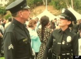 Officer Pat Cronin and his daughter, Officer Jamie Carganilla. (AP)