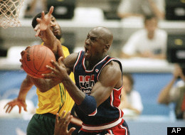 USA's Michael Jordan takes the ball to the hoop past Brazil's Josuel Aristides Santos at the XXV Summer Olympic Games in Barcelona, Friday, July 31, 1992.