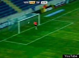 A goalkeeper for Ukrainian team Goverla attempts to deflect a back-pass from defender Evgen Eliseev.