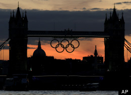 The Olympic rings hang from the Tower Bridge after sunset on Sunday, July 15, 2012, as London prepares for the 2012 Summer Olympics. (AP Photo/Charlie Riedel)