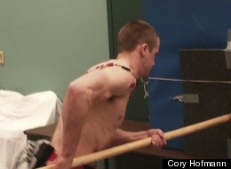 A volunteer performs a spear-thrusting task like a Neanderthal would as electrodes monitor his muscle activity.