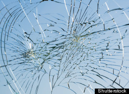 Michael Steven Poret, a broker at UBS Financial Services, has been accused of smashing dozens of windows of local businesses with a slingshot.