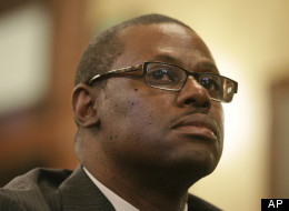 Illinois Rep. Derrick Smith, D-Chicago, listens to fellow lawmakers while attending a legislative committee hearing investigating whether Smith should be disciplined over a bribery charge at the Illinois State Capitol Thursday, May 10, 2012 in Springfield, Ill. (AP Photo/Seth Perlman)