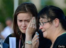 AURORA, CO - JULY 20: Dara Anderson (L) and Monique Anderson cry during a candelight vigil on July 20, 2012 in Denver, Colorado.