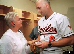 Cal Ripken Jr., right, speaks with his mother Vi Ripken after a press conference after the Orioles game with the Tampa Bay Devil Ray in which Ripken hit his 400th career home run in the third inning, Thursday, Sept. 2, 1999 in Baltimore. (AP Photo/John Gillis)