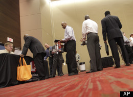 Job seekers line up to speak to a recruiter during a job fair Thursday, July 19, 2012, in Irving, Texas