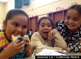 Guadalupe Chavez, who will be in second grade this fall, eats a free summer lunch with friends at Cambridge Elementary School in Concord.