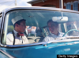 Presumptive Republican presidential candidate, former Massachusetts Gov. Mitt Romney sits in a 1961 Rambler with car owner, Michael Scheib, on June 17 in Troy, Ohio. (Photo by Joe Raedle/Getty Images)