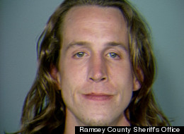 Christopher Meusburger allegedly threatened his 62-year-old neighbor with a sword after she criticized the way he treated a book she lent him.