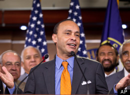 Rep. Luis Gutierrez, D-Ill., center, accompanied by fellow House members, talk about the Dream Act during a news conference on Capitol Hill in Washington, Thursday, Aug. 2, 2012. (AP Photo/J. Scott Applewhite)