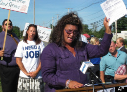 Lynn Tipton, front, president of a local union and a worker at the Rhode Island Department of Labor and Training, addresses a crowd during an event held to protest layoffs at the department on July 25 in Cranston, R.I. (AP Photo/David Klepper)
